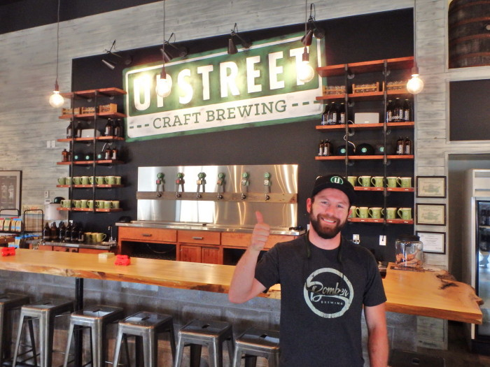Joey Seaman giving a tour of the Upstreet Taproom